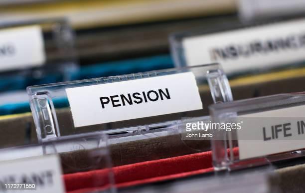 pension label tab on file - fondo pensionistico personale foto e immagini stock