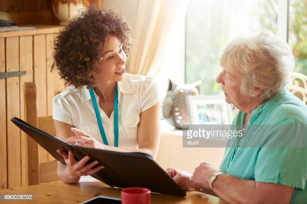 pensioner advice - social services stock pictures, royalty-free photos & images