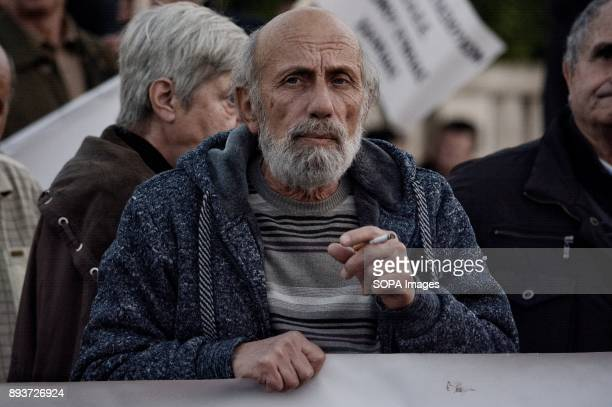 Pensioner holds banner during the protest of pensioners at Syntagma Square They are protesting to the government of pension cuts and austerity...
