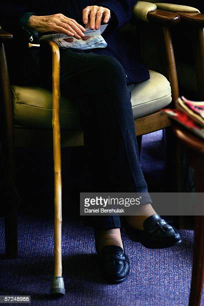 Pensioner holds her walking aid during a group exercise in a day care centre on April 4 2006 in London England The State Pension Commission today...