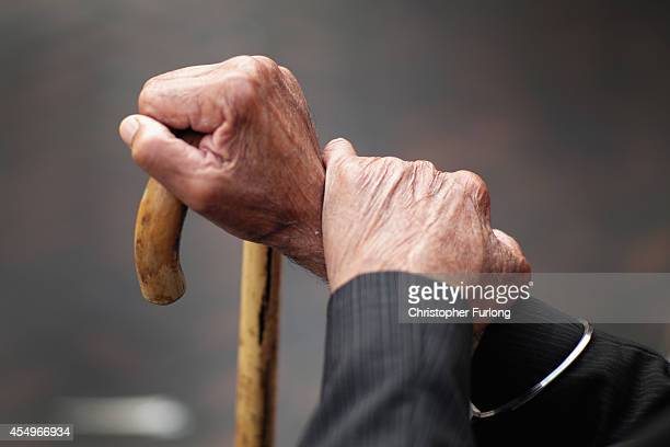A pensioner holds his walking stick on September 8 2014 in Walsall England Britain is facing multiple problems stemming from an increase in the...