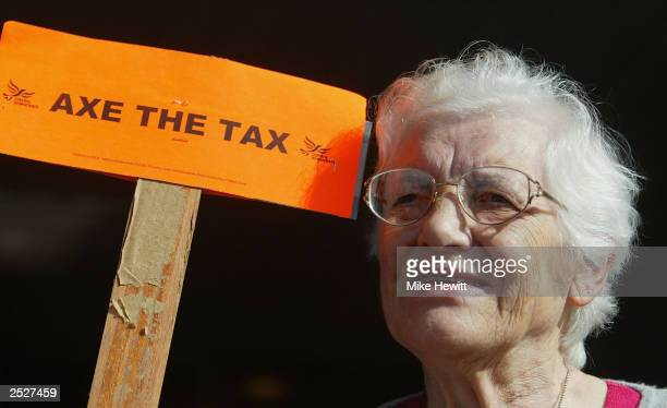 Pensioner Marjorie Russell form Dorset West protests about the Council Tax taking place at the Brighton Centre during the Liberal Democrat Conference...