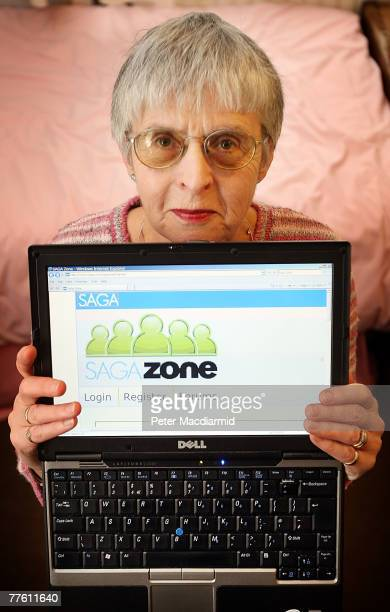 Pensioner Mary Devlin holds a laptop computer displaying the Saga Zone website on November 1 2007 in London England A social networking site for the...