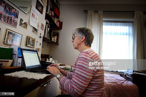Pensioner Mary Devlin uses a laptop computer at home on November 1 2007 in London England A social networking site for the over 50s has been launched...
