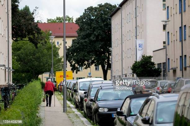 Pensioner outside residential apartment blocks on the Carl Legien modernist housing estate, operated by Deutsche Wohnen SE, in Berlin, Germany, on...