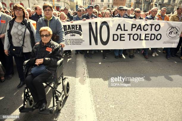 A pensioner seen at the demonstration in her wheelchair Ten of thousands of pensioners took to the street of Barcelona during a protest called by...