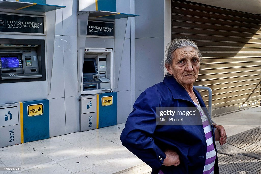 A pensioner stands outside of a branch of the National Bank of Greece hoping to draw her pension on June 29, 2015 in Athens, Greece. Greece closed its banks and imposed capital controls on Sunday to check the growing strains on its crippled financial system, bringing the prospect of being forced out of the euro into plain sight.