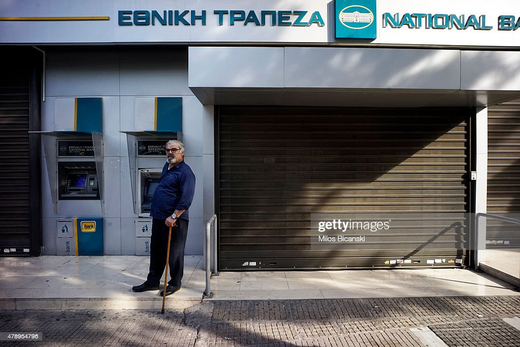 A pensioner stands outside of a branch of the National Bank of Greece hoping to draw his pension on June 29, 2015 in Athens, Greece. Greece closed its banks and imposed capital controls on Sunday to check the growing strains on its crippled financial system, bringing the prospect of being forced out of the euro into plain sight.