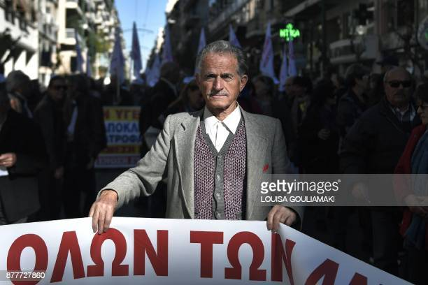 A pensioner takes part in a demonstration against deep cuts to pensions and measures included in the government's draft 2018 budget on November 23...