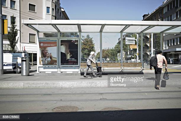 A pensioner uses a wheel walker mobility device while walking beneath a tram shelter in Zurich Switzerland on Wednesday Aug 23 2017 On September 24...