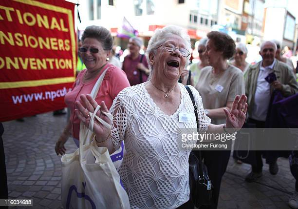 Pensioners dance to the music of a New Orleans style jazz band as they arrive to attend their annual Pensioners Parliament at The Winter Gardens on...
