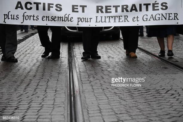 Pensioners demonstrate along with striking EHPAD employees on March 15 2018 in Strasbourg eastern France as part of a nationwide movement of retired...