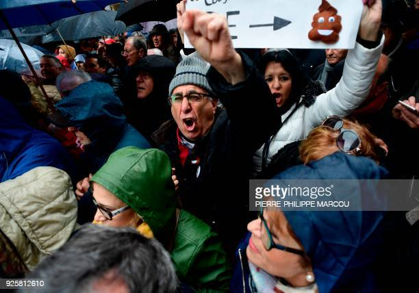 TOPSHOT Pensioners demonstrate in Madrid on March 1 2018 during a protest to call on the government to raise pensions and defend the social security...