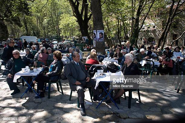 Pensioners eat Easter lunch in the shade of trees on April 4 2010 in Livadia Greece Greece has requested financial assistance from the International...