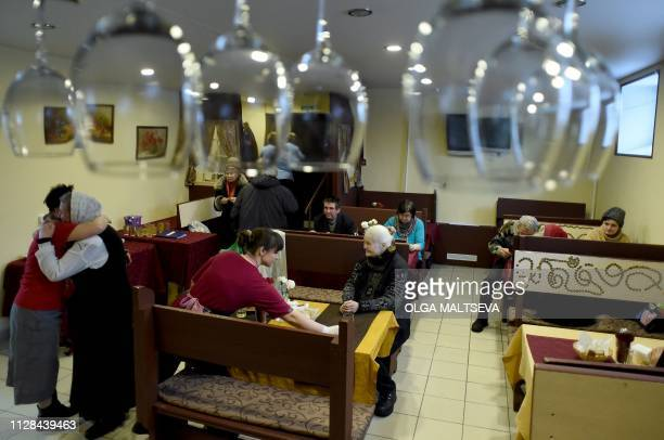 Pensioners enjoy free midday meal at the Dobrodomik cafe in Saint Petersburg on February 11 2019 At a Saint Petersburg cafe a singer performs...