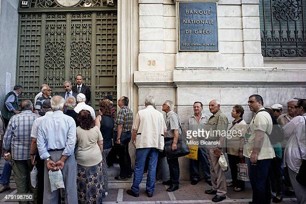 Pensioners line up outside a National Bank branch on July 2 2015 in Athens Greece As people continue to queue outside banks Greek finance minister...
