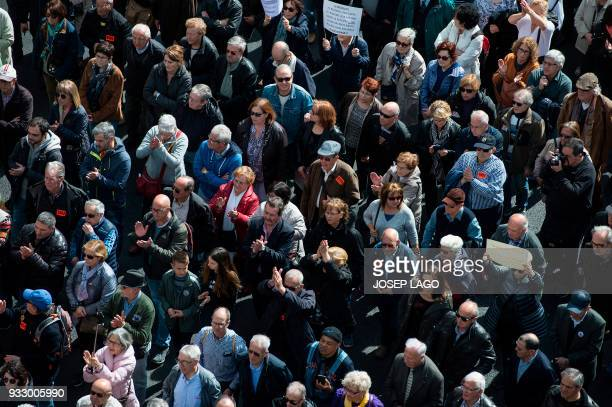 Pensioners march in Barcelona on March 17 during a protest called by 'Marea Pensionista' and supported by the main Spanish unions demanding decent...