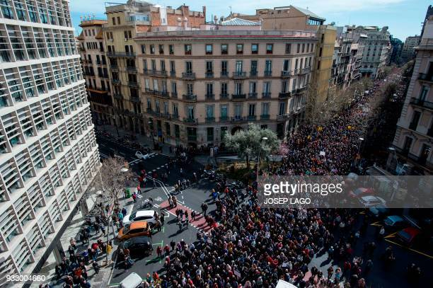 Pensioners march in Barcelona on March 17 during a protest supported by the main Spanish unions demanding decent pensions and to defend their rights...