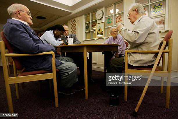 Pensioners play a game of dominoes on May 19 2006 in London England A deal on pensions has been agreed between Tony Blair and Gordon Brown and an age...