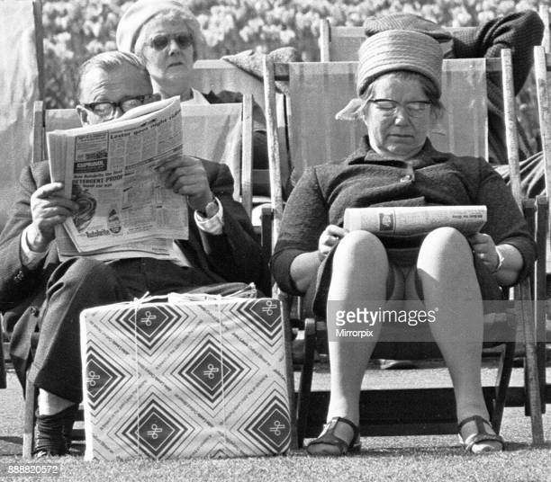 Pensioners reading the newspaper whilst enjoying the afternoon sun in Embankment Gardens 3rd June 1968