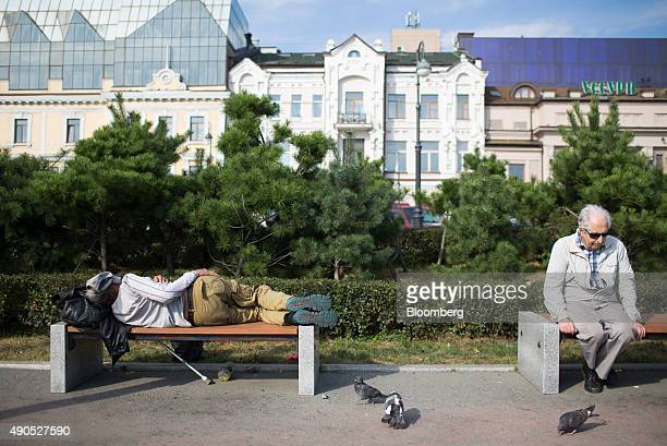 Pensioners rest on park benches in Vladivostok Russia on Sunday Sept 27 2015 'It is simply impossible to predict how global markets will perform and...