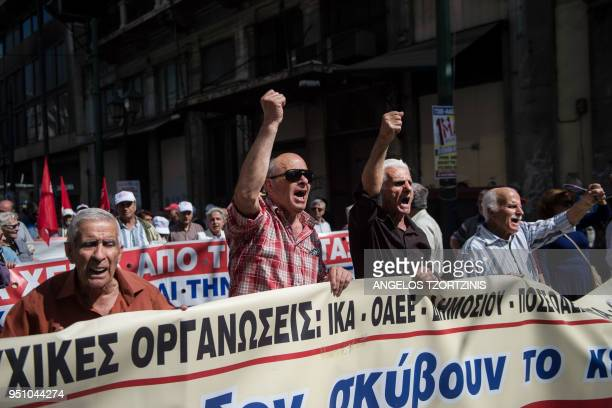 TOPSHOT Pensioners take part in a demonstration as they march towards the Ministry of Finance to protest against planned pension reforms in central...