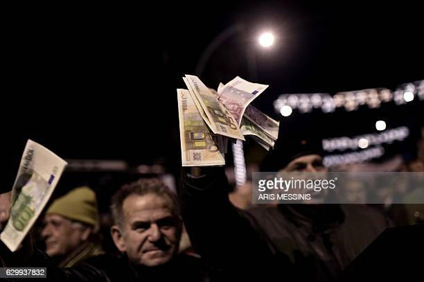 TOPSHOT Pensioners take part in an antiausterity demonstration in central Athens on December 15 2016 Greek lawmakers approved a pension handout that...