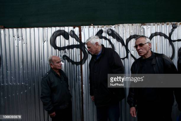Pensioners take part to a protest organized by the Communist affiliated PAME labor union during a 24hour strike in Athens on November 28 2018