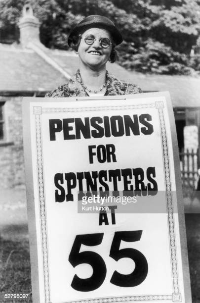 'Pensions for Spinsters at 55' A member of the National Spinsters' Pensions Association wearing a sandwich board 8th October 1938 Original...