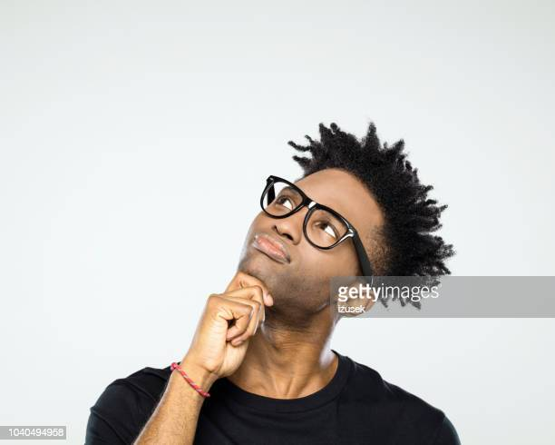 pensive afro american man looking up at copy space - asking stock pictures, royalty-free photos & images
