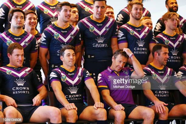 A pensive Billy Slater and head coach Craig Bellamy are seen during the team photoshoot during a Melbourne Storm NRL media opportunity at AAMI Park...