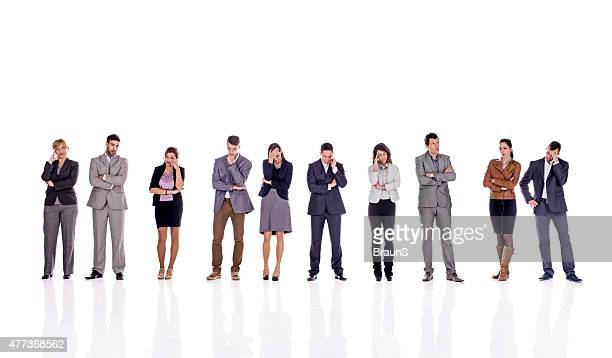 pensive business people in a line. isolated on white. - distraught stock pictures, royalty-free photos & images