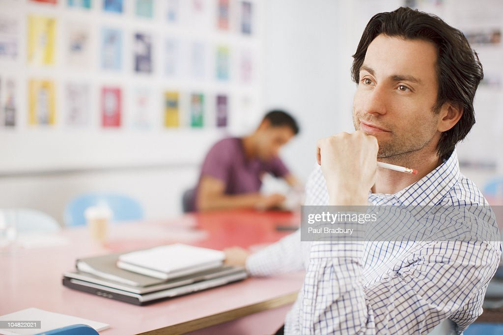 Pensive businessman in office : Stock Photo