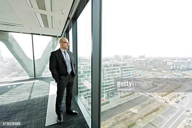 Pensive businessman on empty office floor