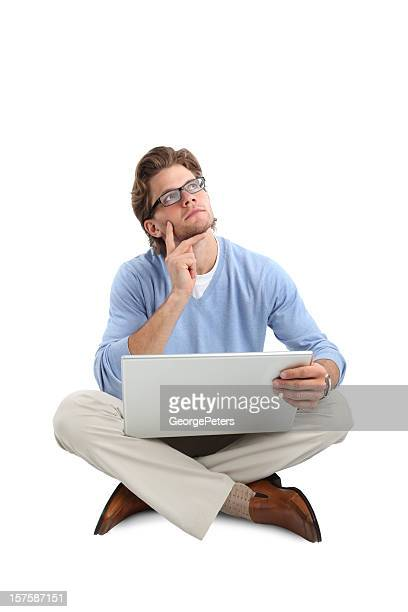 Pensive Businessman with Computer