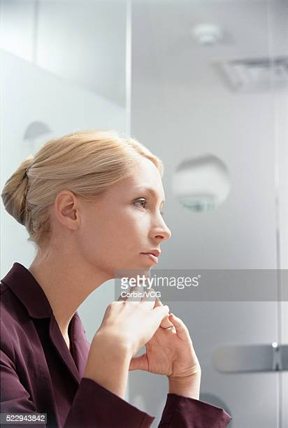 pensive businesswoman in her office - vcg stock pictures, royalty-free photos & images