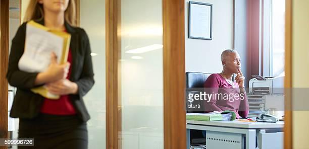 pensive businesswoman in her office