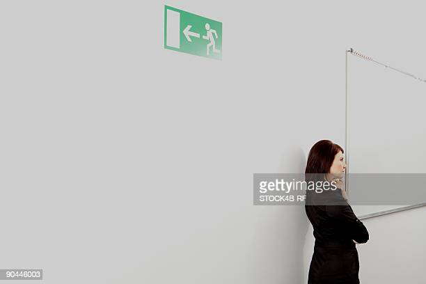 Pensive businesswoman on office corridor, Munich, Bavaria, Germany