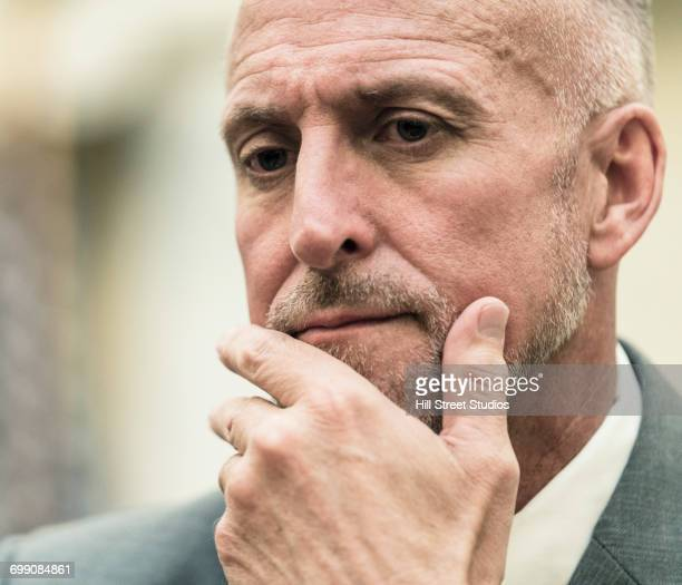 pensive caucasian businessman - tensed idaho stock photos and pictures