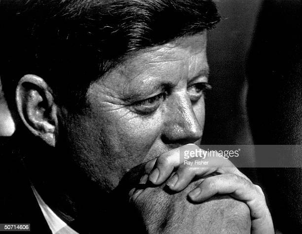 Pensive closeup of US President John F Kennedy during a banquet