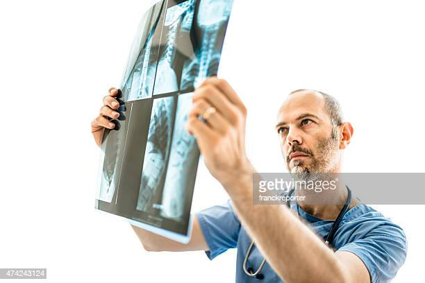 Pensive doctor looking the xray