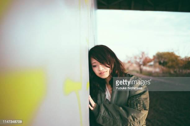 pensive girl - yusuke nishizawa stock-fotos und bilder