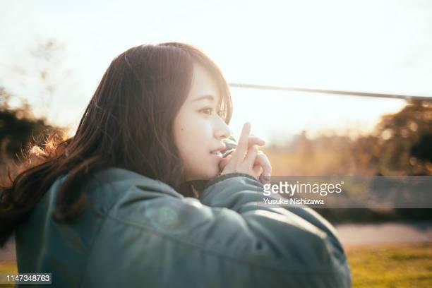 pensive girl - yusuke nishizawa stock pictures, royalty-free photos & images