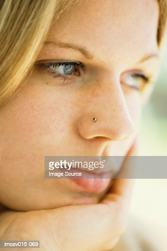 Pensive Girl High-Res Stock Photo - Getty Images