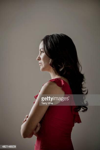 Pensive Hispanic woman looking away