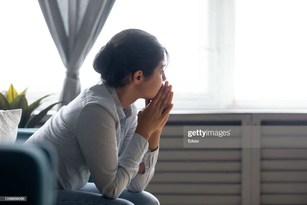 Pensive indian girl lost in thoughts suffering from depression : Stock Photo