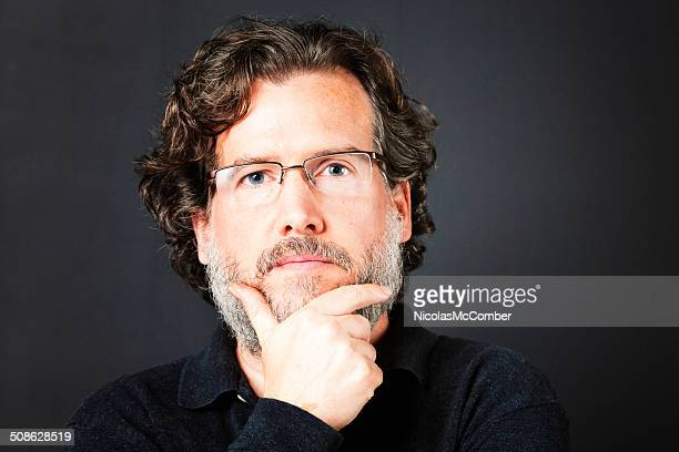 pensive intellectual bearded mature man - moustache stock pictures, royalty-free photos & images