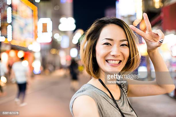 pensive japanese woman on the phone