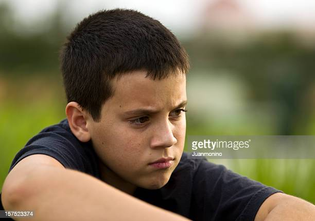 pensive little boy - autism spectrum disorder stock photos and pictures