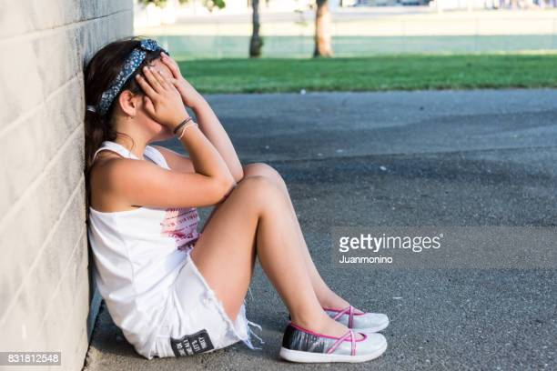 pensive little girl - autism spectrum disorder stock photos and pictures